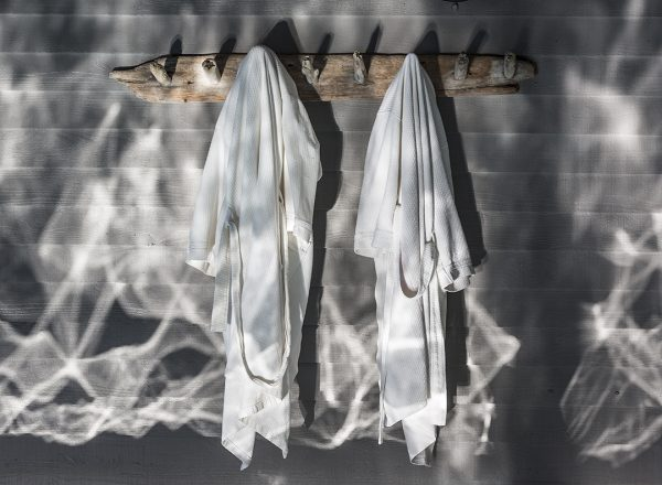robes hung up on hooks at a spa resort