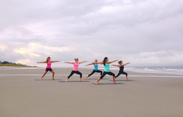 Hilton Head Health Retreat practicing yoga on the beach to help extinguish burnout
