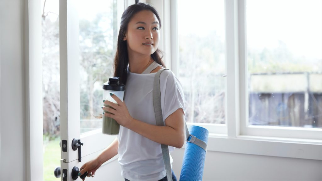 woman practicing self care by exercising and eating right