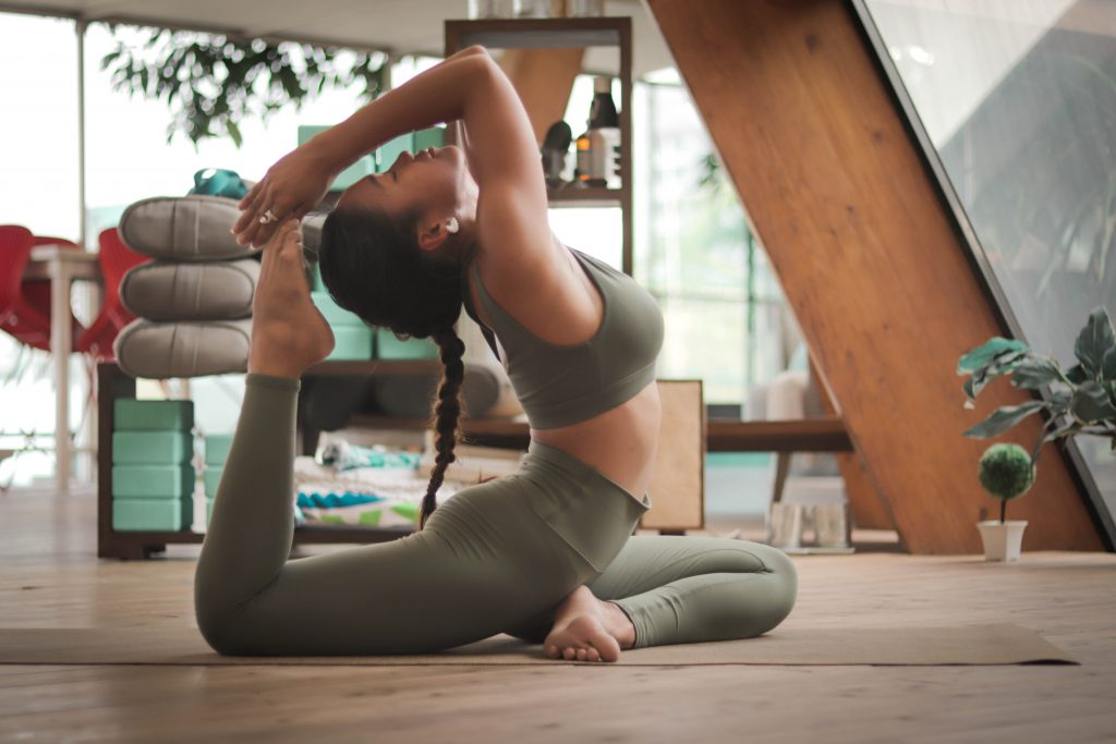 girl practicing fitness-on-the-go with yoga exercise when traveling