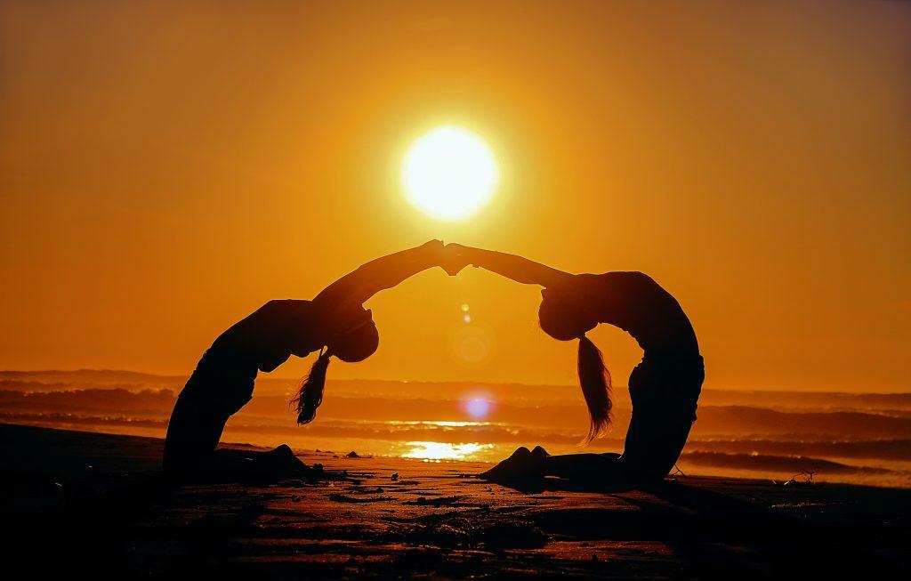 connecting through yoga - are yoga retreats worth it - unsplash
