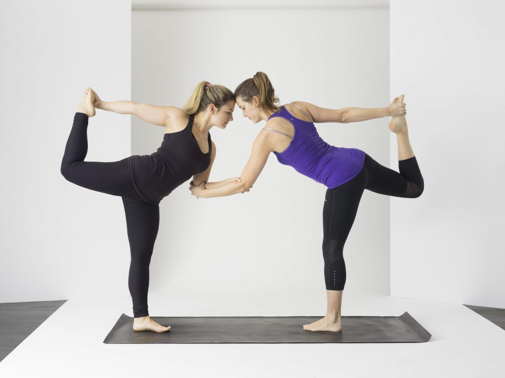 learning new yoga pose - are yoga retreats worth it - unsplash