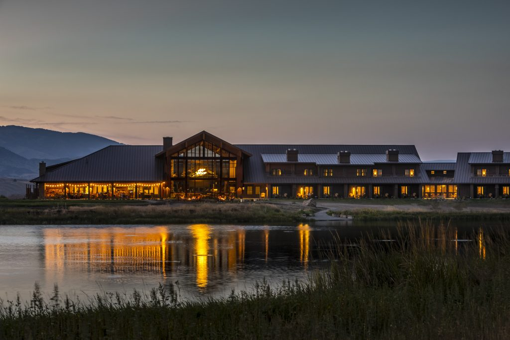 The exterior of Sage Lodge in the evening