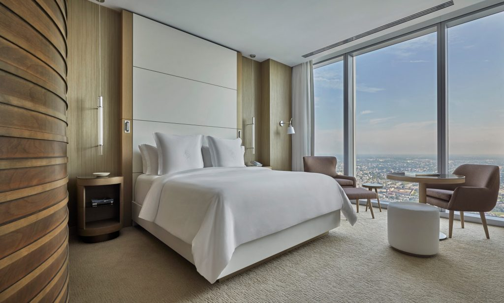 bed and view of city from room in four seasons philadelphia