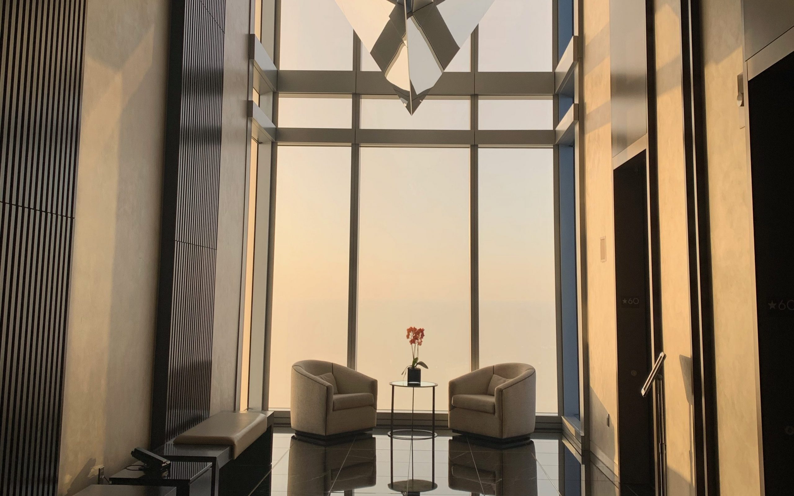 elevators at the four seasons philadelphia with the sunset in the distance