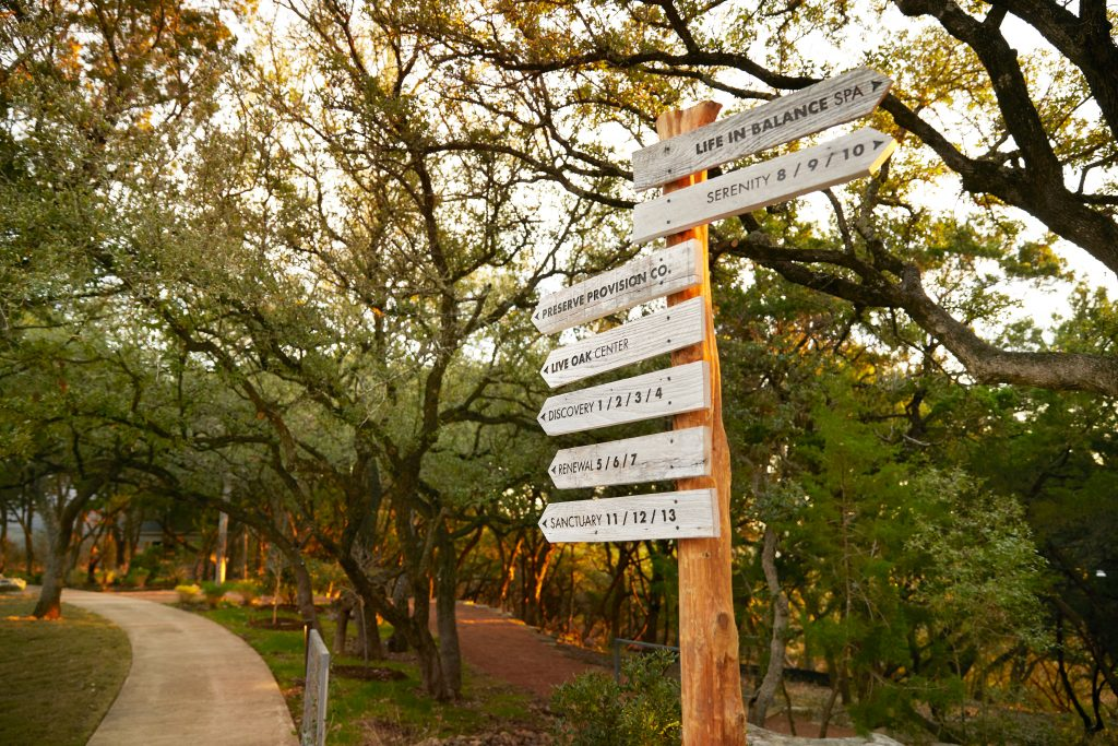 signs that point to various locations in miraval austin