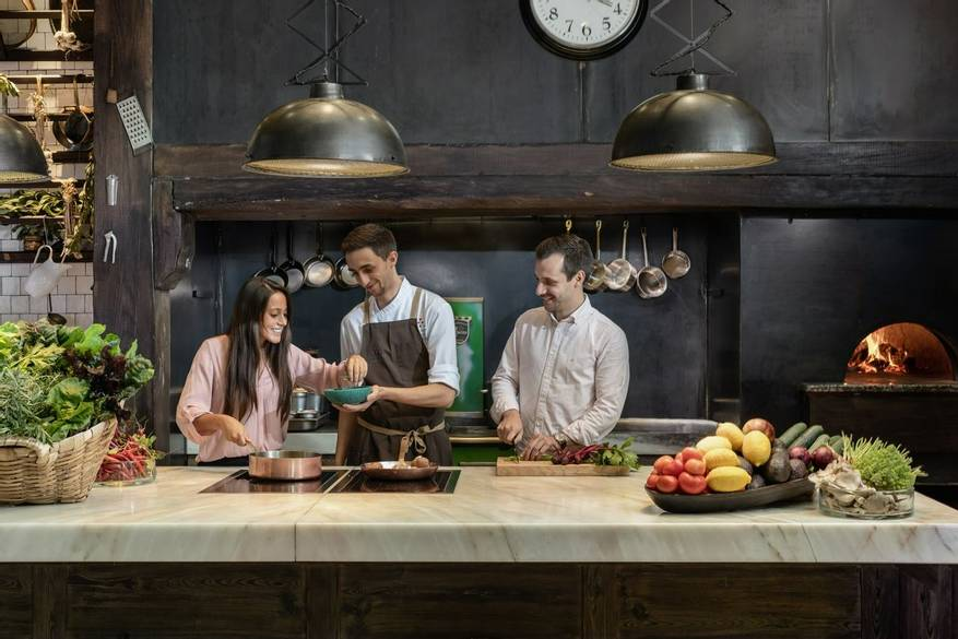 a couple taking cooking classes at six senses duoro valley - winter getaway