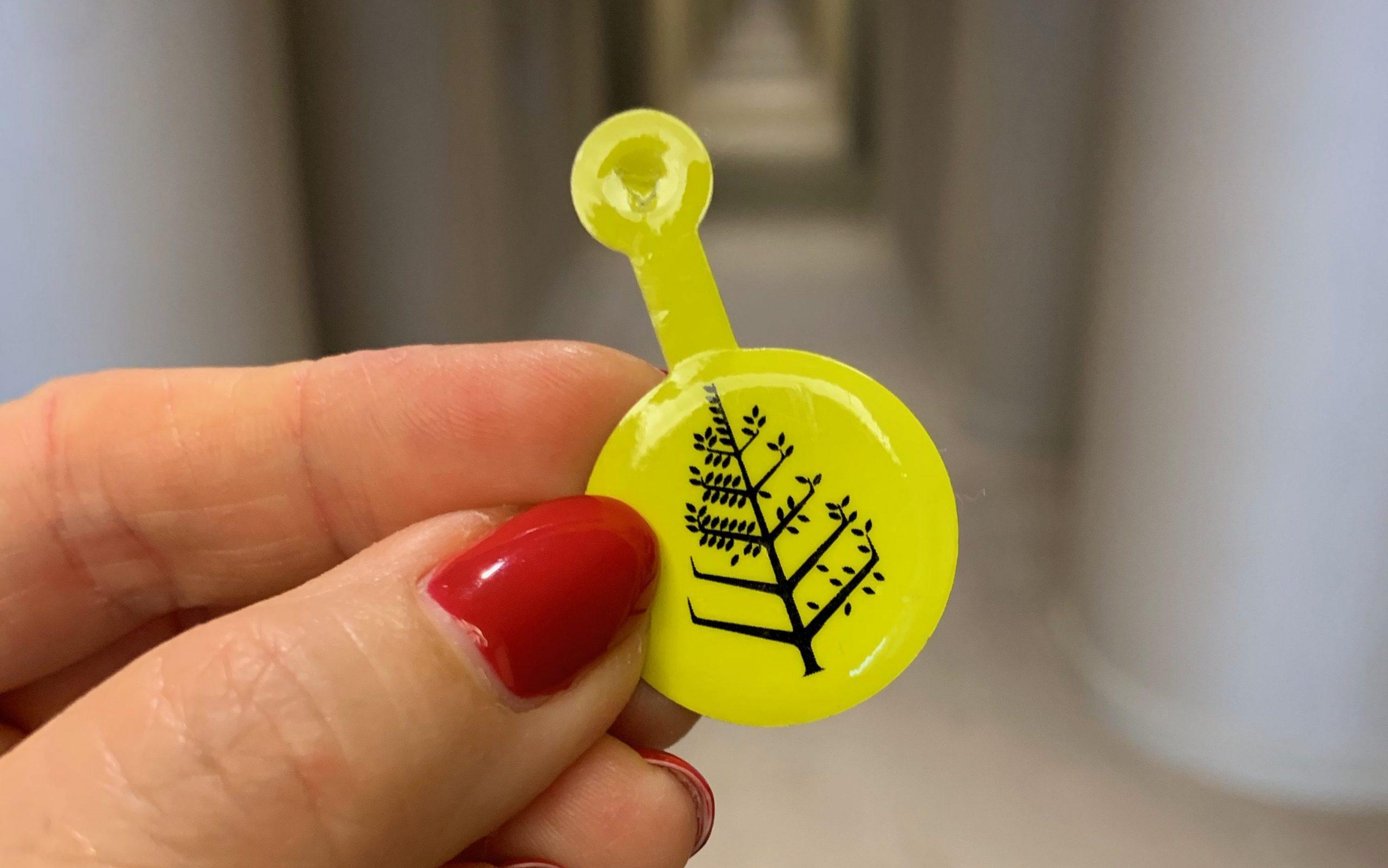 yellow covid-19 badge