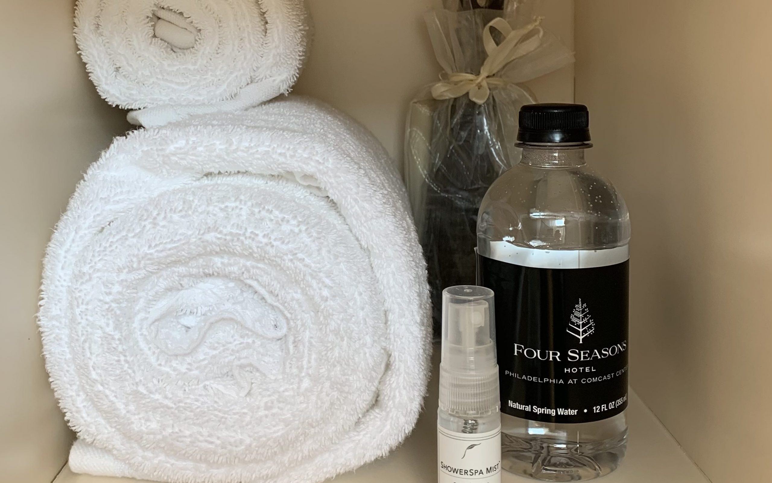 spa locker with towel, water, and various amenities