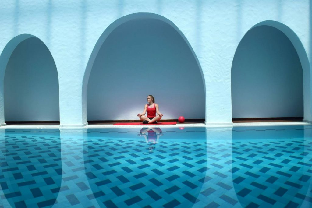 A woman relaxing by the spa at Aegialis Hotel and spa