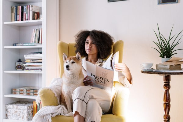 woman cozy with dog at home